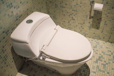 Modern Toilet bowl in a men bathroom,white ceramic flush toilet for men in toilet room