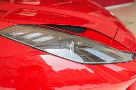 Predatory car headlight and hood of powerful sports car with matte paint. Banque d'images