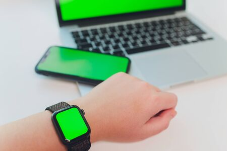watch by use multiple internet electronic devices with green screen.
