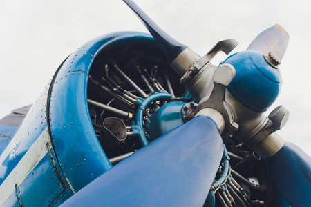 Close up view of a vintage propeller passenger and cargo airplane. Imagens