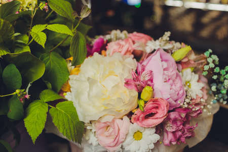 Bouquet of varied flowers in different colors.