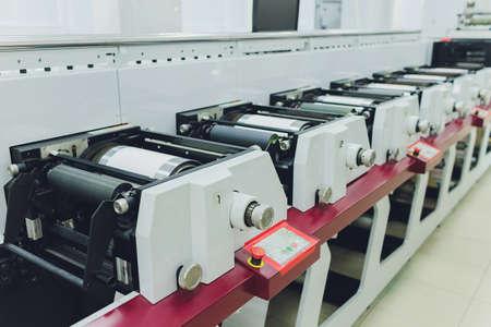 Print screening metal machine. Industrial printer. Serigraphy workshop.