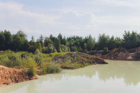 Open pit asbestos quarry lake with blue water. Imagens