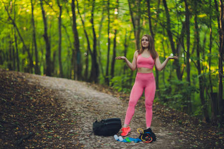 Young smiling woman hiker hiking mountain trail, walking on grassy hill, wearing backpack. Outdoor activity, tourism concept. Imagens - 152444813