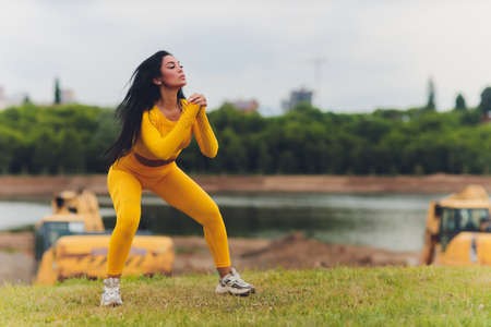Attractive girl doing sports on a summer day in tights and vests with hair tied back. 写真素材