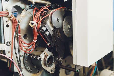 Print screening metal machine. Industrial printer. Serigraphy workshop. Archivio Fotografico