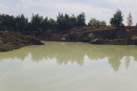 Open pit asbestos quarry lake with blue water. Archivio Fotografico