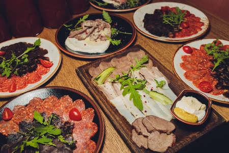 Russian appetizer for vodka. Lard and rye bread. Meat platter. Food background.