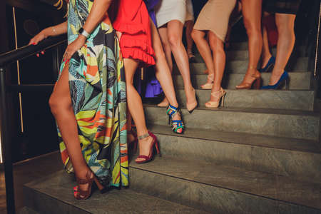 Close up of womens legs in high heels shoes.