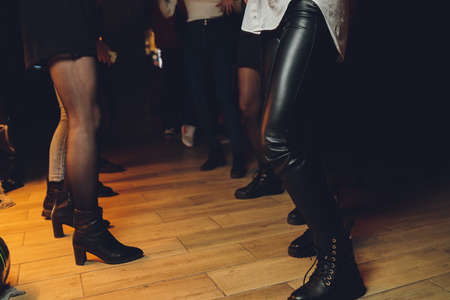 feet of people dancing on a club party. unrecognizable.