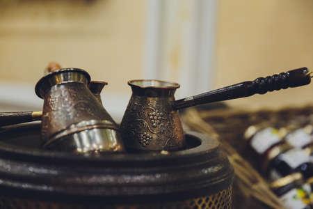 Coffee turk still life on a sackcloth background. 免版税图像