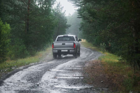 road wet muddy of backcountry countryside in rainy day. 免版税图像