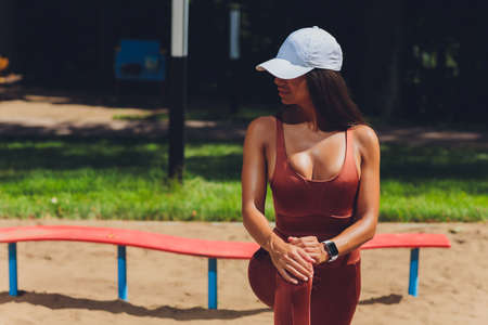A beautiful young woman is engaged in sports on a street simulator. Concept of good physical shape and healthy lifestyle. Standard-Bild - 158724185