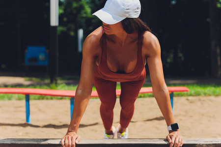 A beautiful young woman is engaged in sports on a street simulator. Concept of good physical shape and healthy lifestyle. Standard-Bild - 158724489