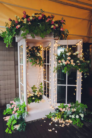 white phone booth and colourful flowers. decoration