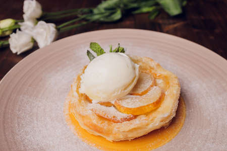 Apple Strudel with Ice Cream. On a wooden background. Top view. Free space for text. Фото со стока