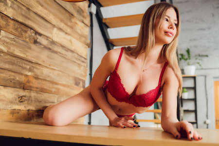 young woman in lingerie in her kitchen. 免版税图像