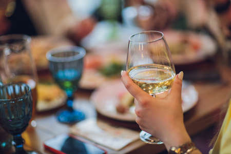 Clinking glasses with alcohol and toasting, party. Stock Photo - 167227346