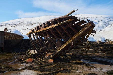 Aerial view of a old wooden ship wreck at the beach. Wreckage of schooner Raketa near a shore.