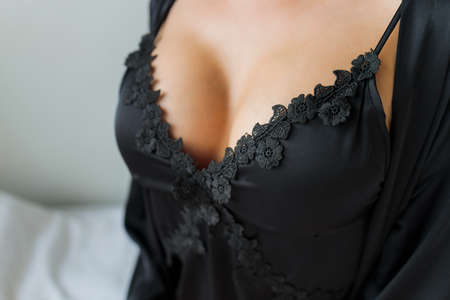 Suntanned beautiful harmonous well-groomed body of the young girl in a brassiere, close up.