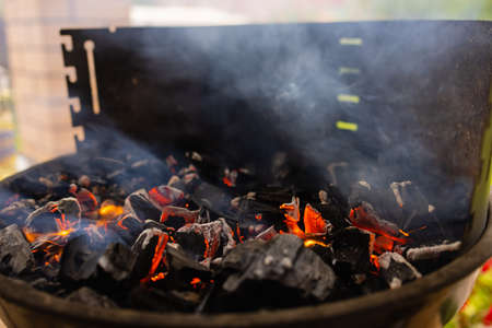 Stock image of charcoal fire grill, close up with live flames.