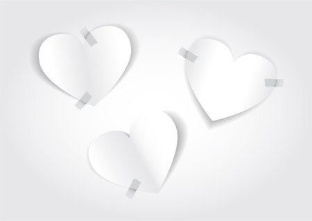 taped: White paper hearts taped on white background