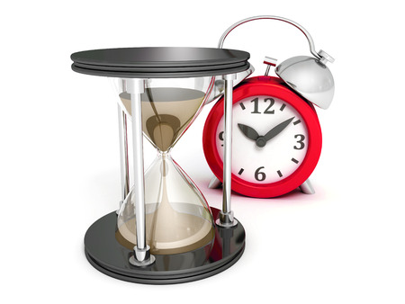 Hourglass and alarm clock on white background photo