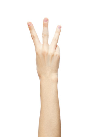 three fingers: hand is showing three fingers isolated on white background. studio photo