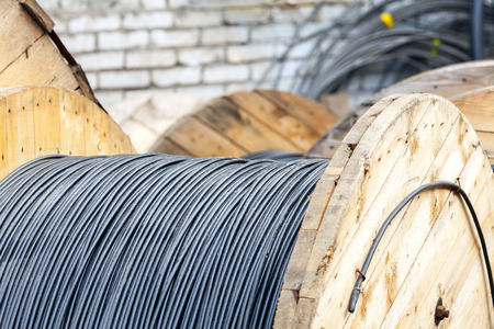 coax: Wooden Coils Of Electric Cable Outdoor. Industrial Object Photo