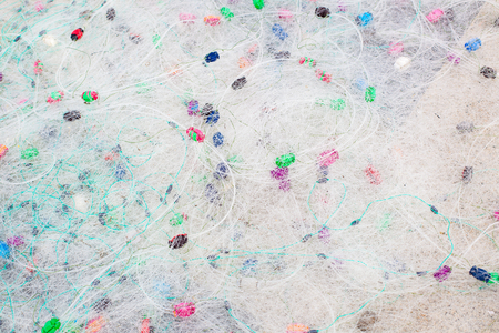 fishingnet: Skein of white fishnet with colorful floats closeup Stock Photo