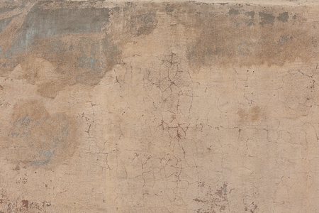 beige: Old cracked plaster textured wall. industrial background