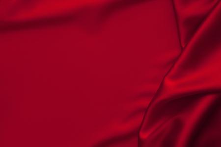 Luxe rode glanzende satijnen stof doek abstracte golvende achtergrond