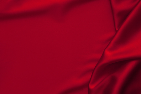 Luxury red shiny satin fabric cloth abstract wavy background