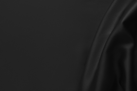 Tela para cortinas de seda brillante ondulada ondulada de lujo negro. Fondo abstracto
