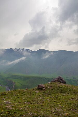 Mountains rocks landscape with cloudy dramatic sky. North nature background.