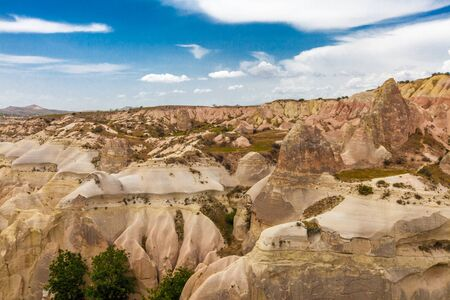 Beautiful mountains rocks landscape. Cloudy sky. Cappadocia, Nevsehir Province, Anatolia Region of Turkey Imagens