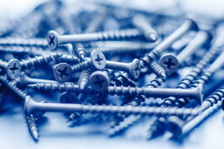 Steel tapping screws abstract background. Industrial pattern concept