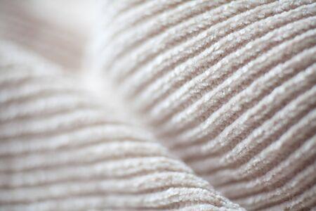 Texture de tissu de laine bouchent l'arrière-plan. Tissu de style douillet. Matériel de plis ondulés Banque d'images