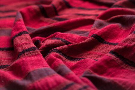 Red woolen fabric cloth background. Wavy texture purple material Archivio Fotografico