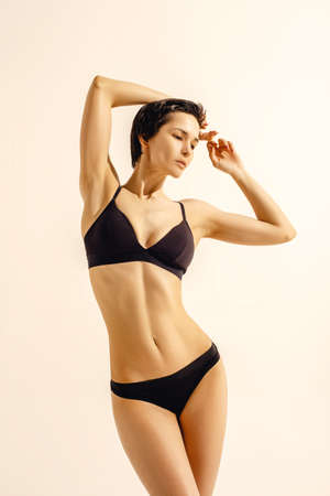 Attractive girl with slim toned body. Beautiful perfect skinny model.