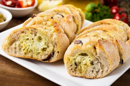 french loaf: fresh baked bread with garlic butter Stock Photo