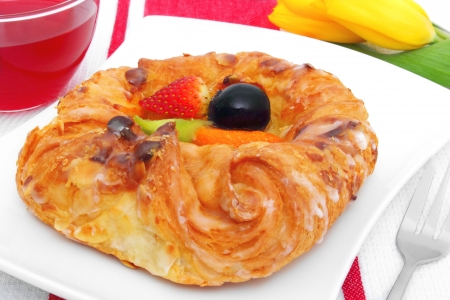 fresh danish pastry with fruits and hot tea  photo