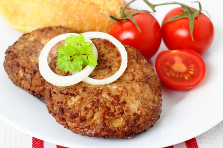 grilled beef steak with tomatoes and fresh baguette photo