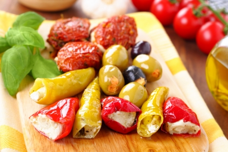 Mixed antipasti plate. Tomatoes, olives and peppers filed with creamcheese.