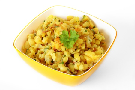 Spaetzle, a noodle speciality with grated cheese    photo