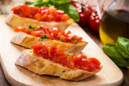 fresh bruschetta on a wooden cutting board