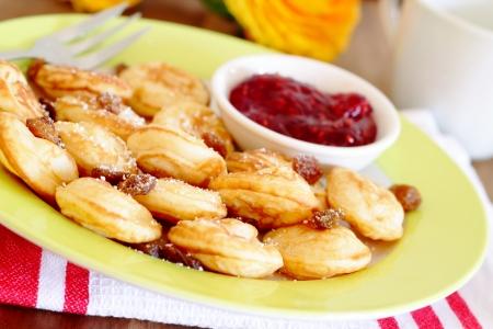 Poffertjes - mini pancakes with raisins, powdered sugar and jam