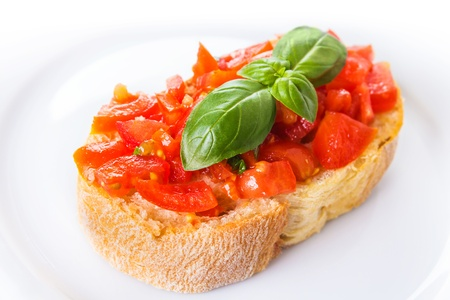 fresh bruschetta with tomatoes on a white plate  Stock Photo