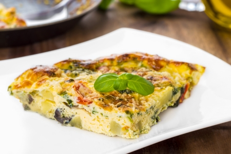 Italian frittata with vegetables and parmesan cheese Stock Photo