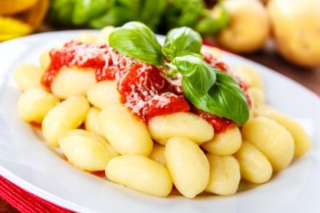gnocchi: fresh italian gnocchi with tomato sauce and parmesan cheese Stock Photo